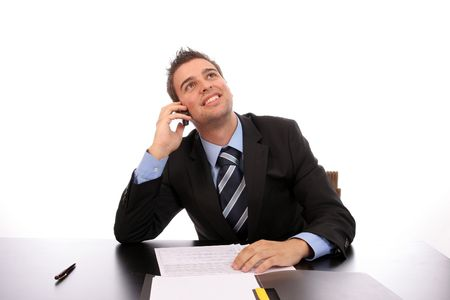 Young happy businessman on the phone, over white background photo