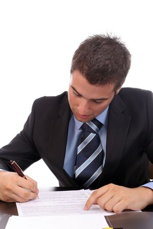young businessman at work, isolated over white photo