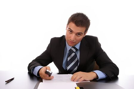 marketeer: Young businessman, working at the desk, isolated on white background Stock Photo