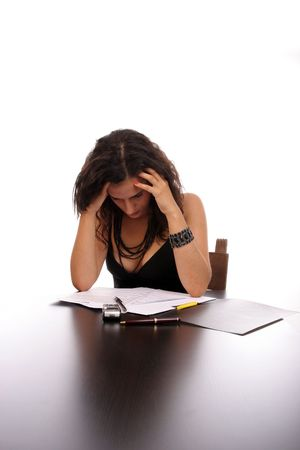 discharge time: Businesswoman with headache at the end of the work day. Stock Photo