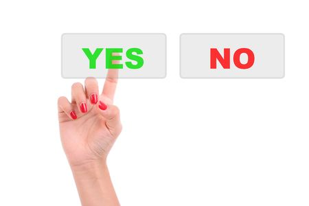 Womans Finger pressing the Yes key - Isolated over white background photo