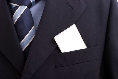 businessman with a blank business card in his pocket, isolated over white photo