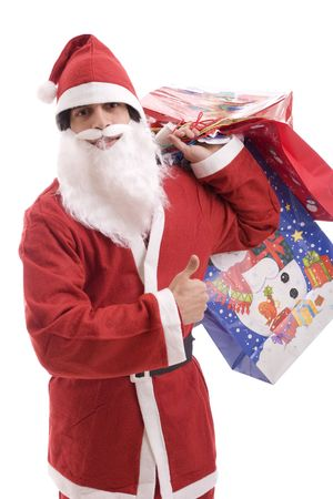 Young Santa Claus, full of gifts, isolated over white photo