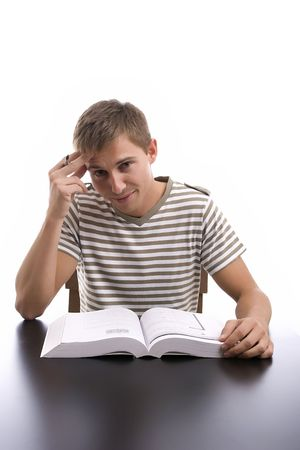 Young boy studying, isolated over white background photo