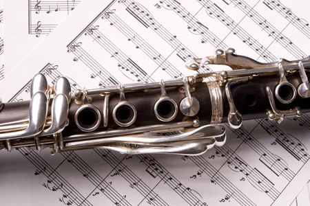 Photograph of a clarinet isolated over sheet music Stock Photo - 4373295