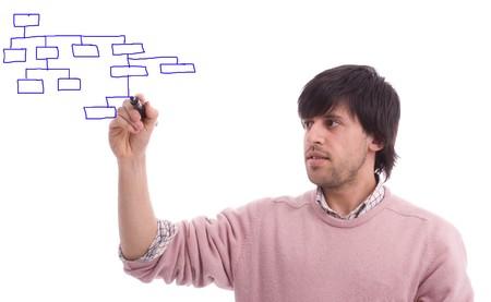 dataflow: Joven hombre de negocios dibujo flujo de datos, sobre fondo blanco aisladas Foto de archivo