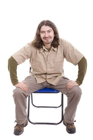 Young man sitting on a chair, isolated over white