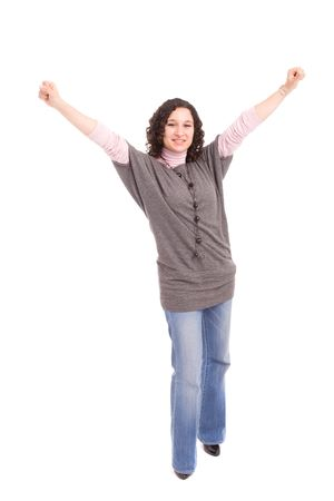 Very happy girl with arms raised, isolated over white Stock Photo - 4862614