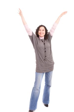 Very happy girl with arms raised, isolated over white photo