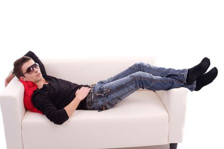 Young casual boy, posing isolated on couch Stock Photo - 5025151