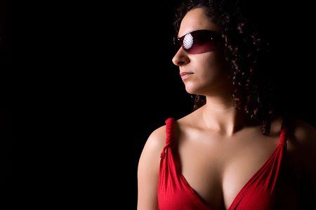 Young girl with sunglasses portrait - low key portrait photo