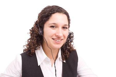 Friendly telephone operator smiling isolated over white Stock Photo - 5284746