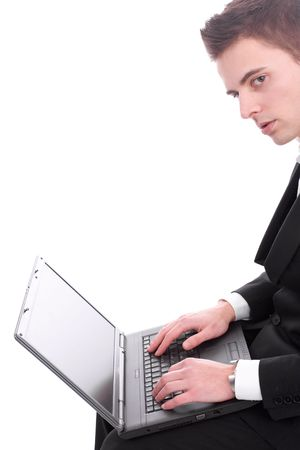 Businessman working with laptop, isolated over white photo