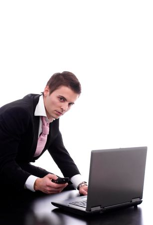 Business man working with laptop, isolated over white photo