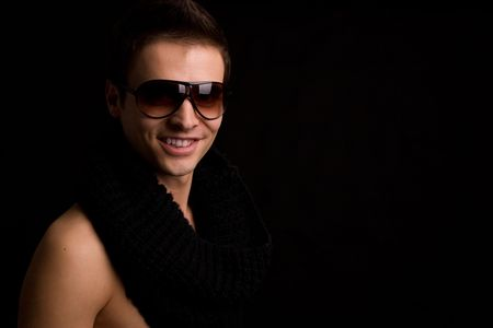 Young boy with sunglasses - low key portrait Stock Photo - 5390447