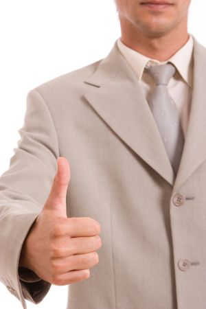 Business man showing thumb up, isolated over white photo