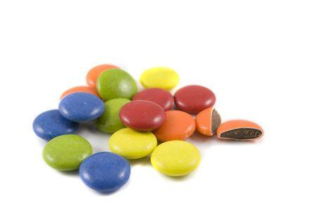 Pile of colored chocolates, isolated over white background