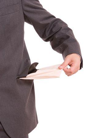 Man holding empty pocket, isolated over white background photo