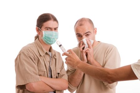 Man infected with h1n1 virus terrorizing his friends - focus on Needle Stock Photo - 5679086