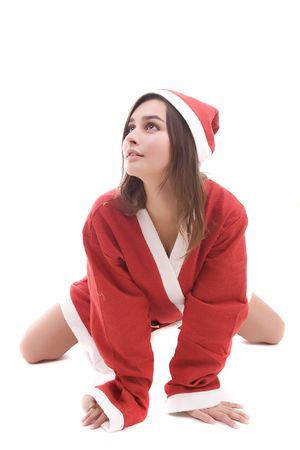 Young Santa Girl posing isolated over white background photo