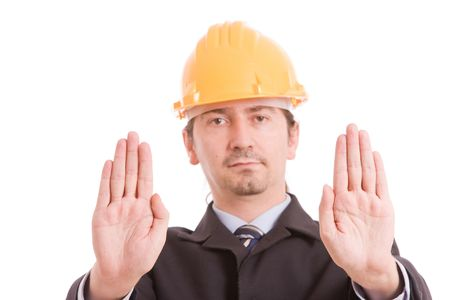 Engineer with yellow hat making stop sign - focus on hands photo