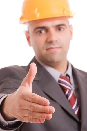Young engineer offering handshake - focus on hand photo