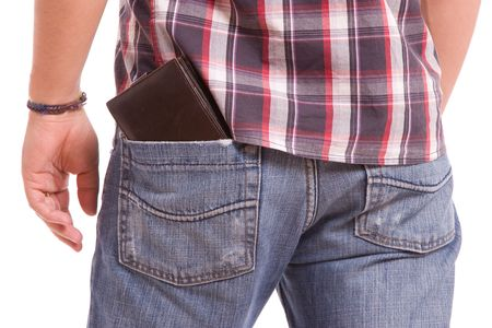hands in pockets: Detail of wallet in mans back pocket