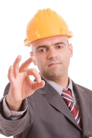 Business man signaling ok - focus on finger photo