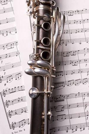 Photograph of a clarinet isolated over sheet music photo
