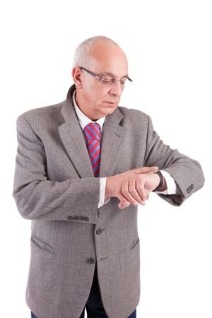 Mature business man consulting his watch, isolated on white photo