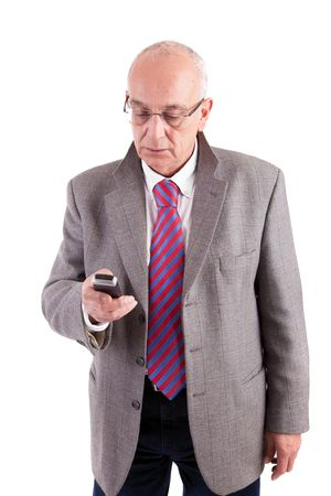 Mature business man at phone, isolated over white background photo