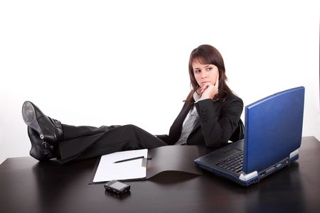 Business woman working with laptop, isolated over white Stock Photo - 6644408