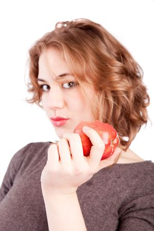 Woman eating red apple - selective focus on apple Stock Photo - 6644415