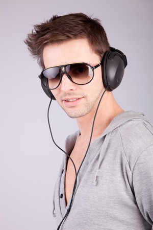 Young man listening to music - isolated photo
