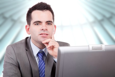 Young business man working with laptop photo
