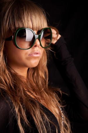 Low Key Portrait - Woman in sunglasses photo