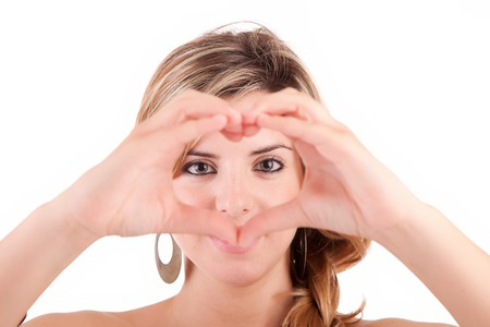 form of heart shaped by the hands of a young woman photo