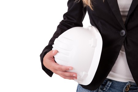Business woman holding an helmet, isolated Stock Photo - 7572641