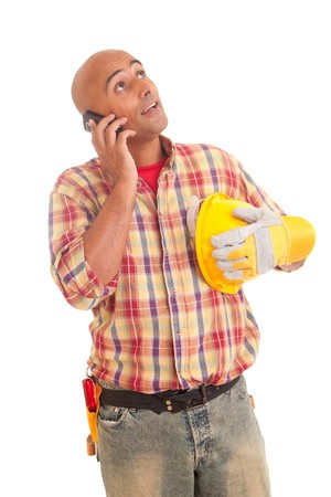 Construction worker at the phone, isolated over white photo