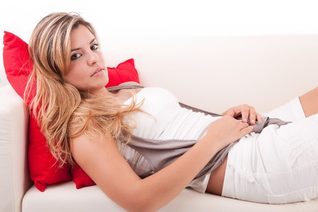 Young woman relaxing on couch - isolated photo