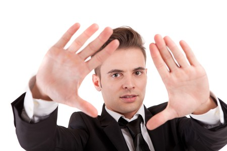 Business man showing framing hand gesture - isolated on white photo