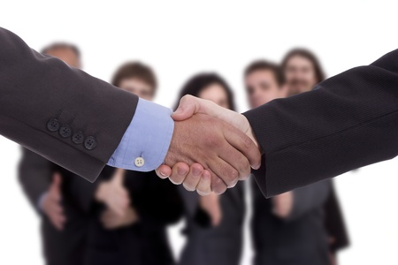 Handshake with business team in background Stock Photo - 9075300