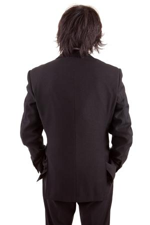 Business man posing backwards, isolated over white photo