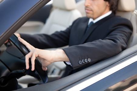 金持ち: 高級スポーツ車の中で若い男 写真素材