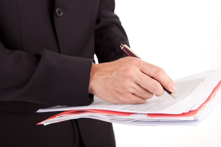 Business man signing document, isolated over white Stock Photo - 11825293