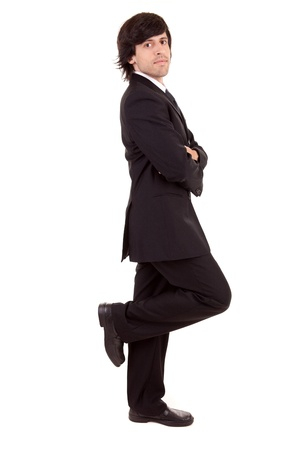 Business man leaning against wall, isolated over white photo