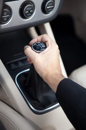 shift: Young man in luxury sports car