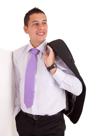 Business man leaning against wall, isolated over white Stock Photo - 11935915