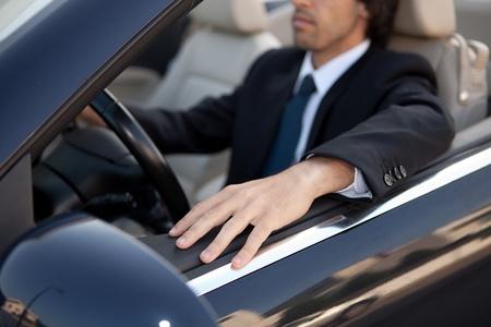 luxury car: Young man in luxury sports car