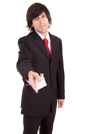 Young business man offering greeting card photo